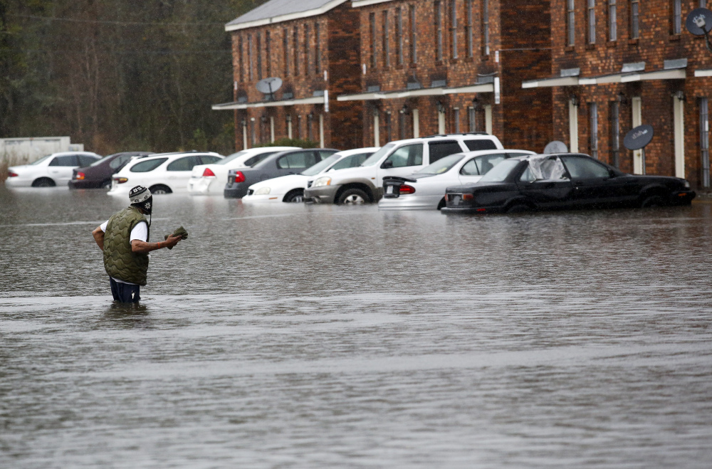 A man wades through floodwaters in Hammond, La., Friday.