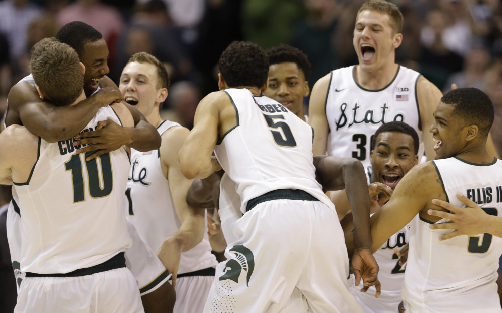 Michigan State players celebrate after beating Purdue 66-62 to win the Big Ten tournament title on Sunday in Indianapolis. The Spartans later were named the No. 2 seed in the Midwest Regional.