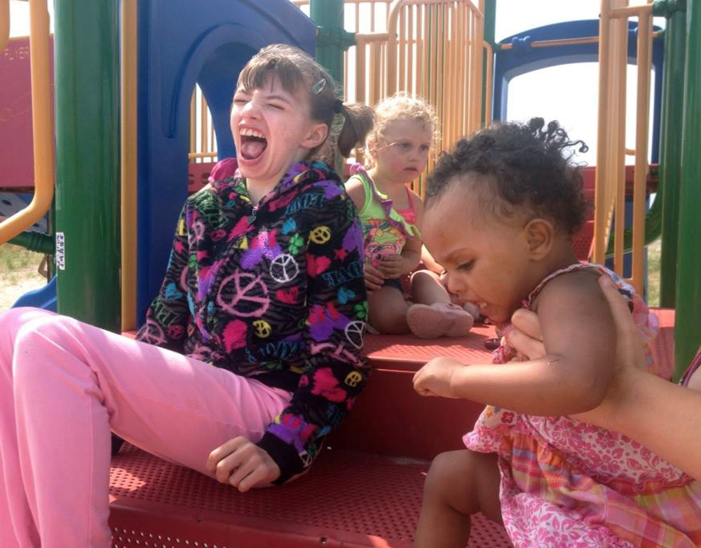 Cyndimae Meehan plays on a playground at Wells Beach with Kaylee Brown, center, and Daliyah Shaur, both of whom, like Cyndimae, have Dravet syndrome. Cyndimae died Sunday.