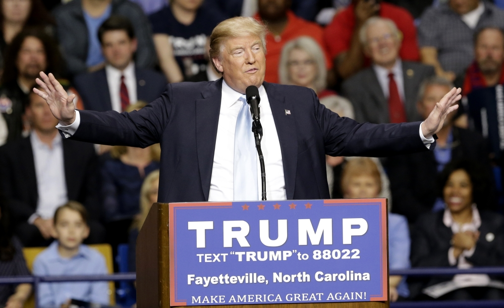 Republican presidential candidate Donald Trump speaks during a March 9 campaign rally in Fayetteville, N.C. Authorities in North Carolina say they are looking at Donald Trump's behavior as they continue their probe of a violent altercation at the rally.