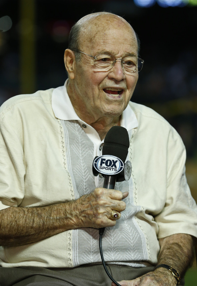 In this April 14, 2013, file photo, Arizona Diamondbacks broadcaster Joe Garagiola speaks during a pregame show prior to a baseball game against the Los Angeles Dodgers, in Phoenix. Former big league catcher and popular broadcaster Joe Garagiola has died. He was 90. The Arizona Diamondbacks say Garagiola died Wednesday, March 23, 2016. He had been in ill health in recent years.