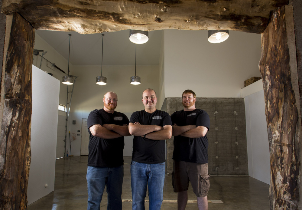 "From left, Alex Anastasoff, John LeGassey and T.J. Hansen, who opened South Portland's Fore River Brewing Co. in January, are eager to hear the wisdom of Dick Cantwell at the beer summit. ""We'll eat it right up,"" LeGassey said."
