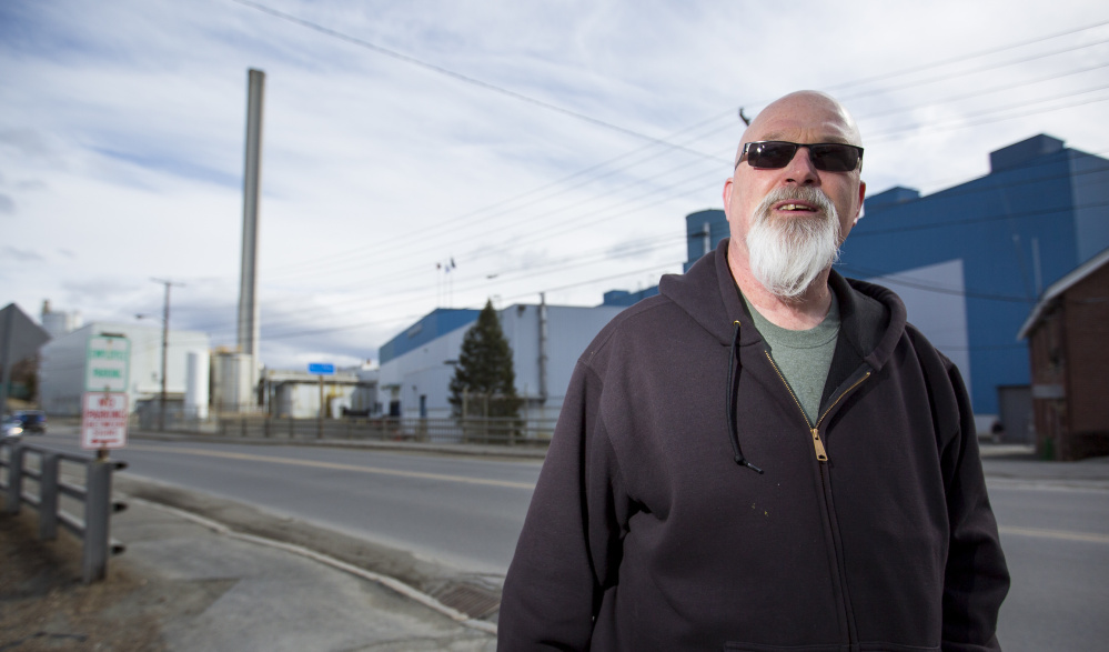 """I guess I'll just ride this to the bottom,"" says millworker Robert Lake, 57, of Skowhegan. He is among more than 200 people who will lose their jobs when Madison Paper Industries closes in May."