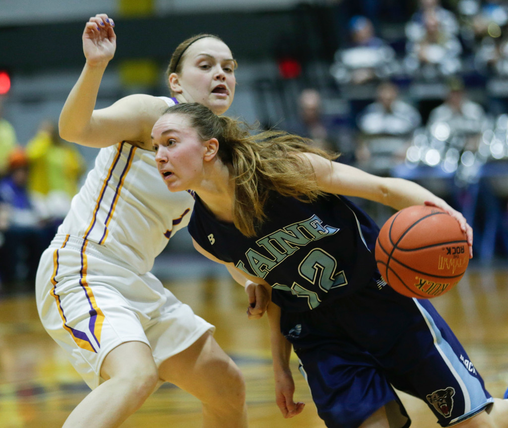 Maine guard Sigi Koizar of Austria drives in front of Albany guard Erin Coughlin during the first half an NCAA women's college basketball game in the America East Conference tournament championship on Friday in Albany, N.Y.