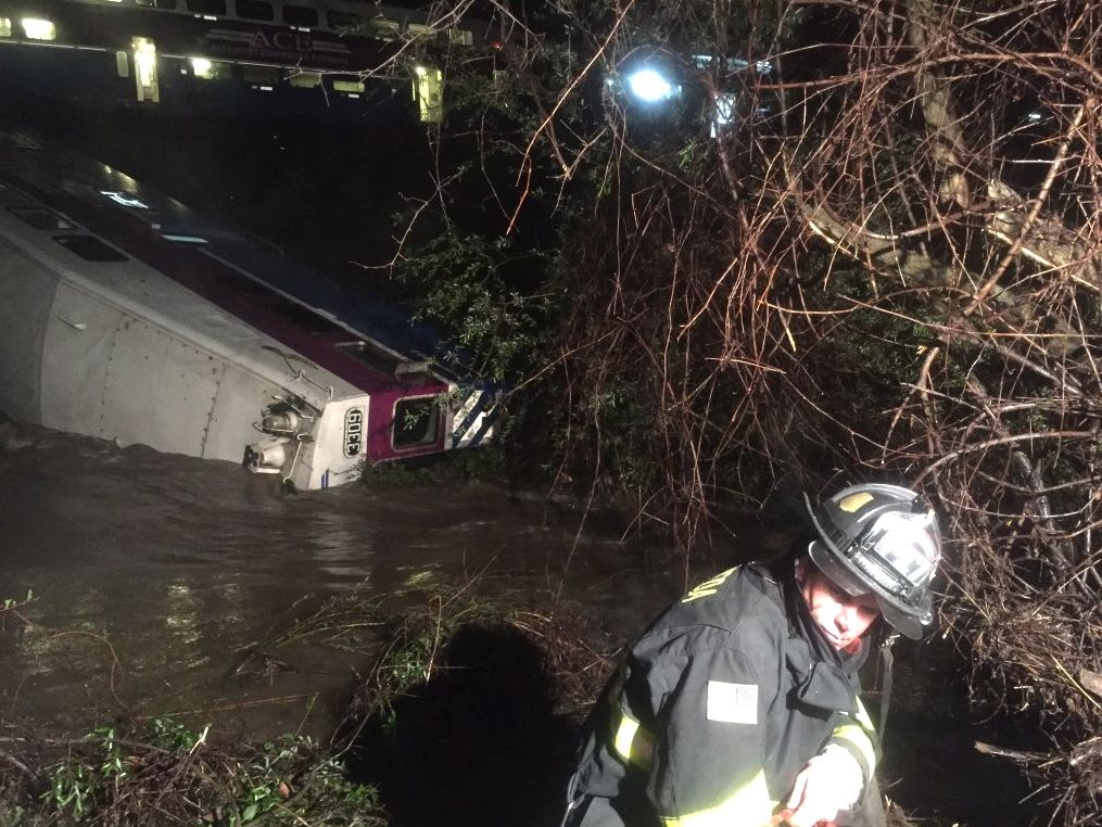 First responders work at the scene after a commuter train car  plunged into Alameda Creek on Mondayin Alameda County, Calif., about 45 miles east of San Francisco. Aisha Knowles/Alameda County Fire Department via AP