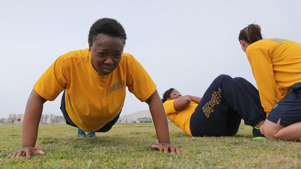 Petty Officer Lentoyi White does pushups while training with fellow Petty Officer Theresa White in Coronado, Calif. The pair are trying to lose weight and improve their fitness in order to pass the Navy fitness test and avert being discharged.