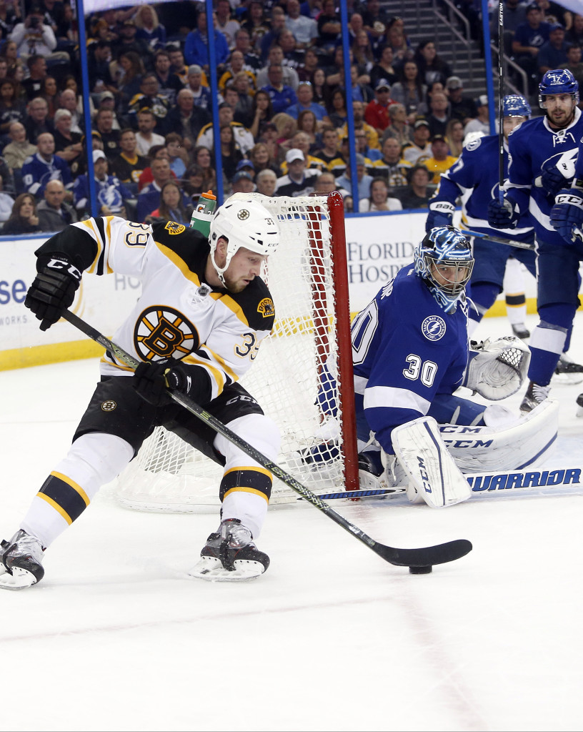 Bruins left wing Matt Beleskey works to put a shot on Tampa Bay goalie Ben Bishop on Tuesday night.    The Associated Press