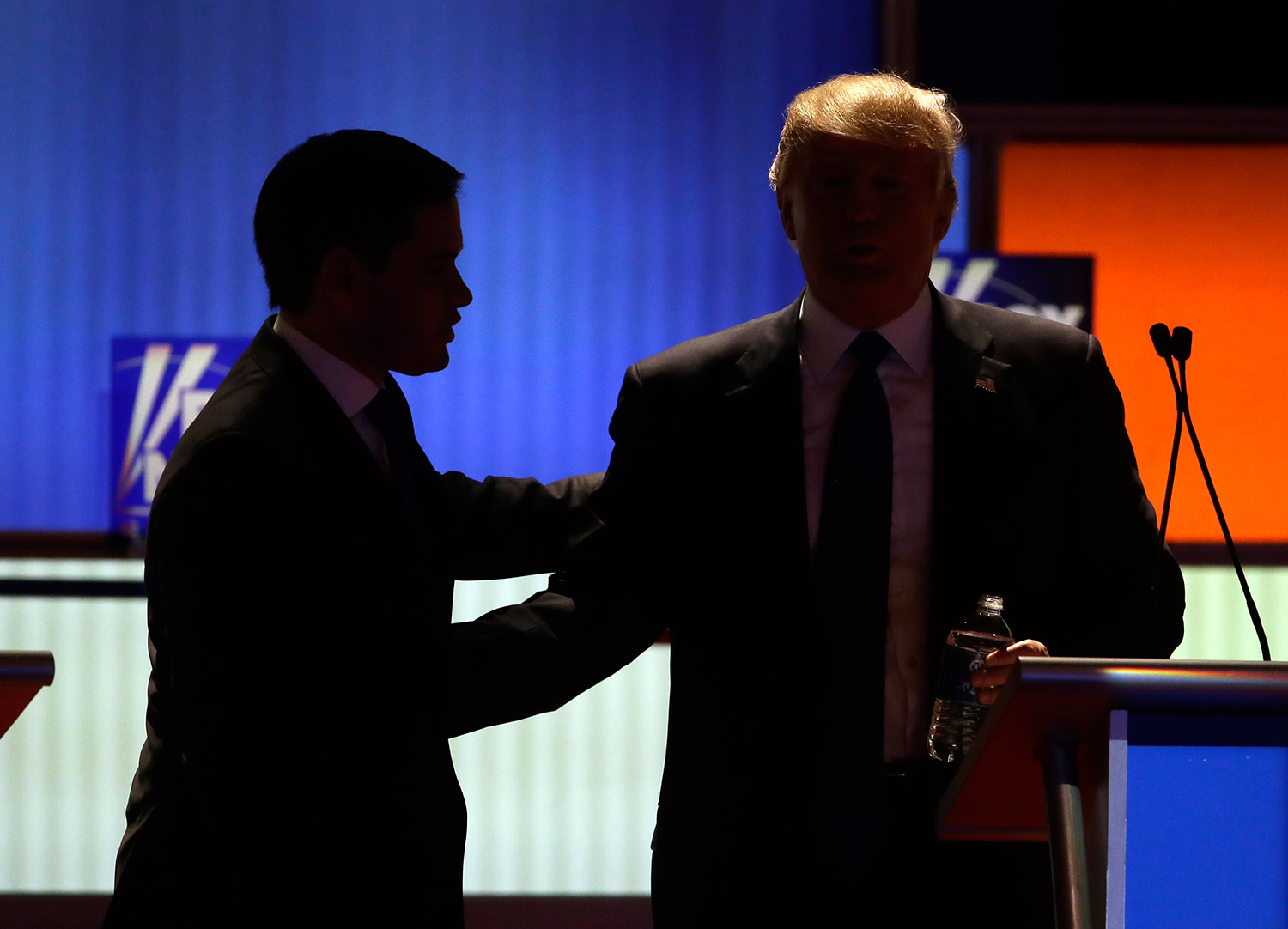 Rubio talks to Trump during a commercial break in Thursday night's debate.