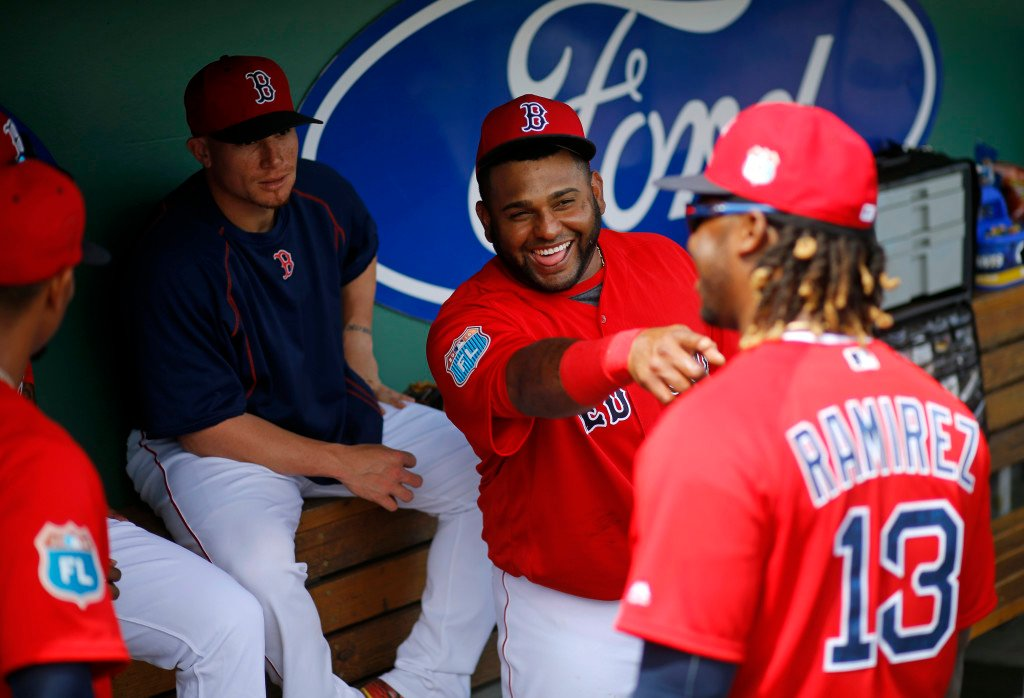 Red Sox third baseman Pablo Sandoval, second from right, seems unbothered by his struggles while teammate Hanley Ramirez says his transition to first base hasn't been easy.   The Associated Press