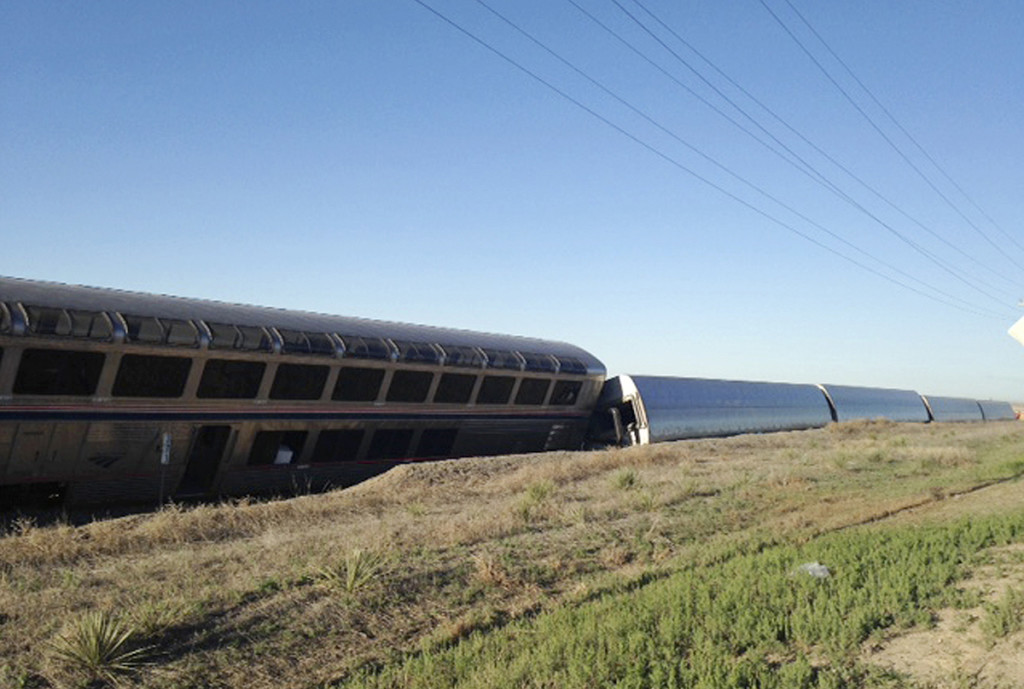 Cars from an Amtrak passenger train lie on their side Monday morning near Cimarron, Kan., after a derailment shortly after midnight resulting in multiple injuries. The Associated Press