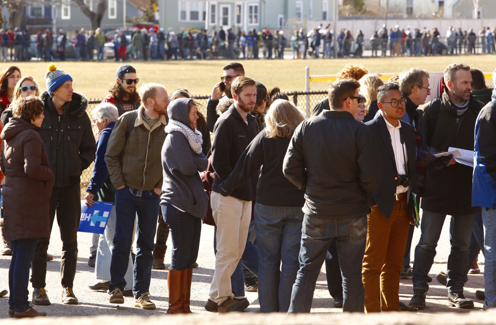 Hundreds of Democratic voters wait in line to caucus at Deering High School in Portland on Sunday. Carl D. Walsh/Staff Photographer
