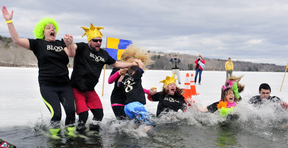 The Bloom/Kelsey team takes their plunge into Maranacook Lake during the Ice Out Plunge Special Olympics fundraiser in this April 11, 2015, file photo.