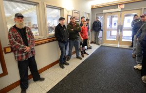A small crowd gathered at Scarborough's town hall for the drawing for a commercial shellfish license. David Green, left, who already had a license, said there's enough competition on the flats and he hoped his sister-in-law would win the license Friday because he didn't think she'd end up using it.