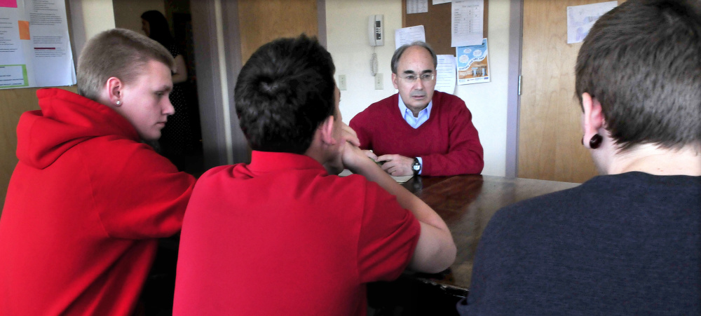 U.S. Rep. Bruce Poliquin, a Republican from Maine's 2nd District, listens to students including Kyle Hendrickson, left, on Tuesday during a tour of the Day One residential substance abuse center on the Good Will-Hinckley campus in Fairfield.