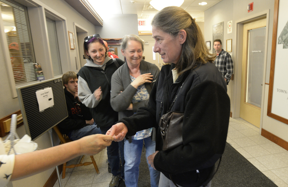 Nancy Rodoalph, right, won Scarborough's lottery Friday for a coveted commercial shellfish license.