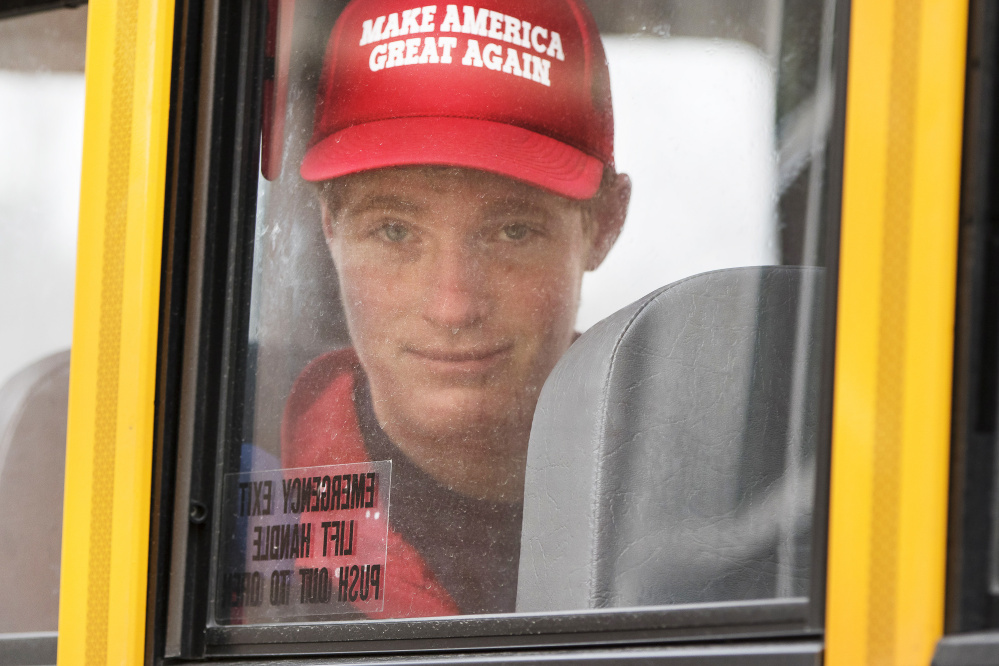 Connor Mullen leaves South Portland High School on the bus Monday. He says he supports Donald Trump because