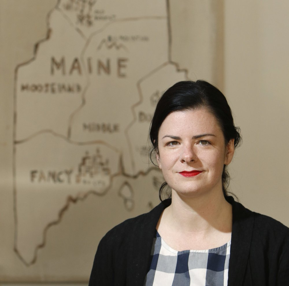 """People have a very romantic view of Maine,"" says Hannah Fettig, who has found success developing knitting patterns. ""A lot of people have been here at least once and they have that as a very positive, nostalgic part of the memory."" The Maine state artwork in the background was painted by Matt Barter."