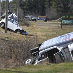 Police say the driver of a box truck, right, swerved on Route 302 in Casco and hit Adam Perron's light-colored Pontiac Vibe on the driver's side Wednesday, sending both vehicles onto the side of the road.