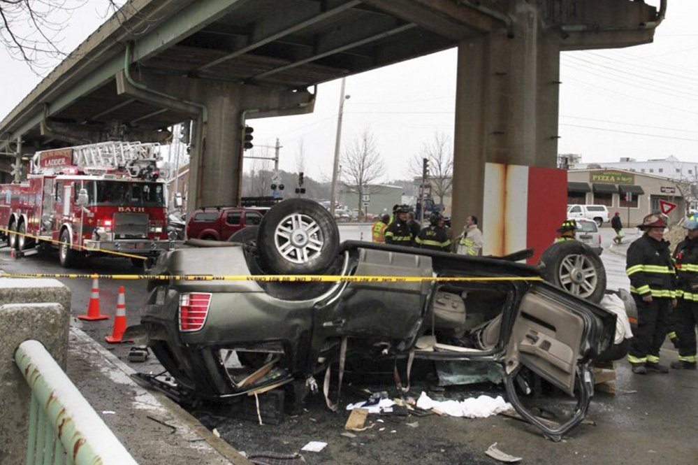 The SUV that crashed through the Bath Viaduct safety railing April 4 sits in the roadway below.