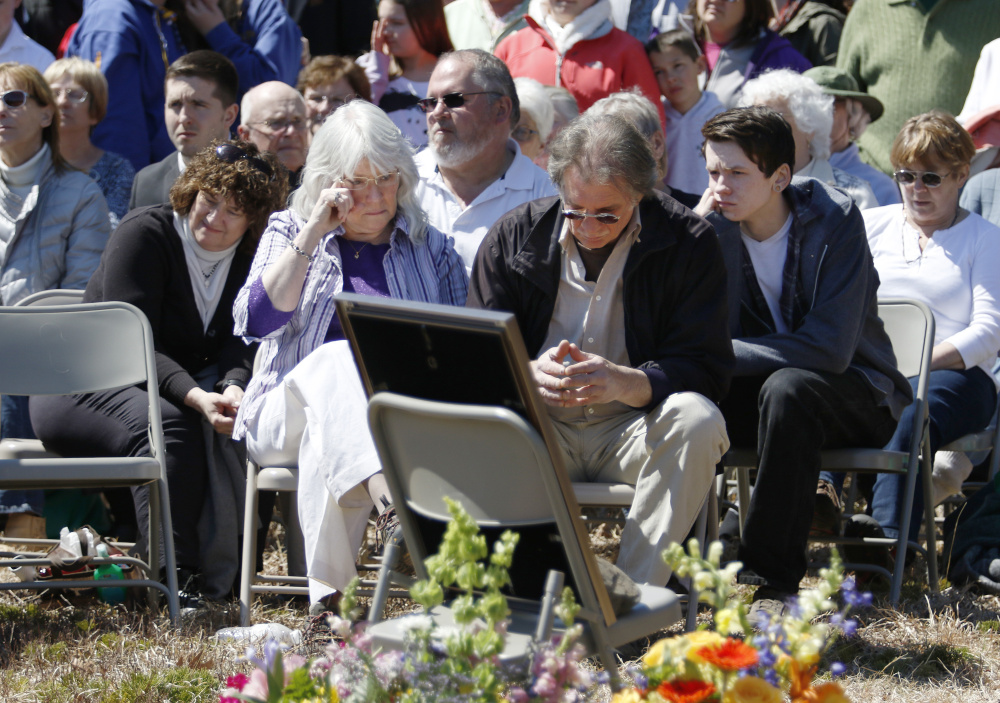 Adam Perron's parents, Dianne Parker and Jeff Perron, listens to speakers Sunday at a memorial service for their son in Naples.