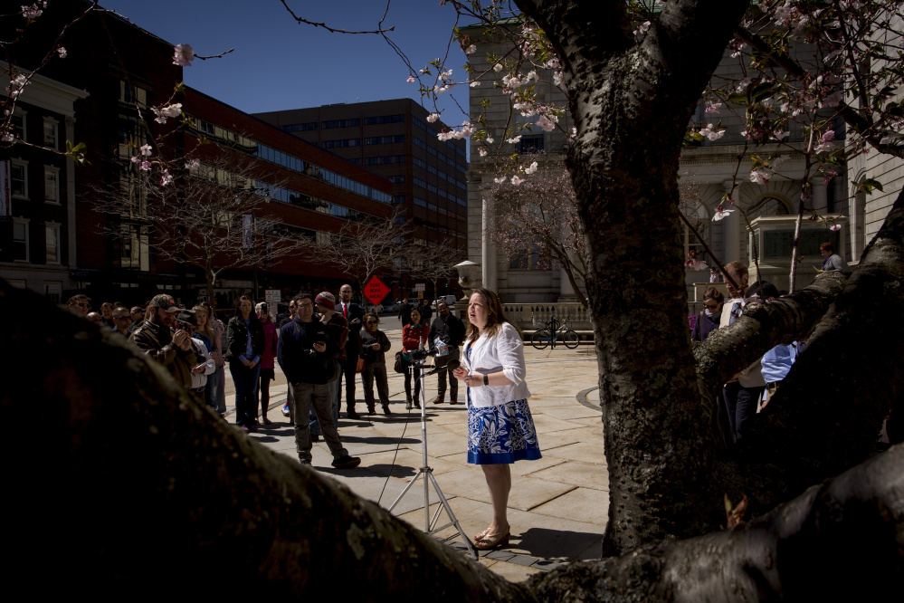 State Rep. Diane Russell, D-Portland, addresses people who attended a news conference and rally at Portland City Hall on Thursday to speak out against the proposed closing of the India Street Public Health Center.