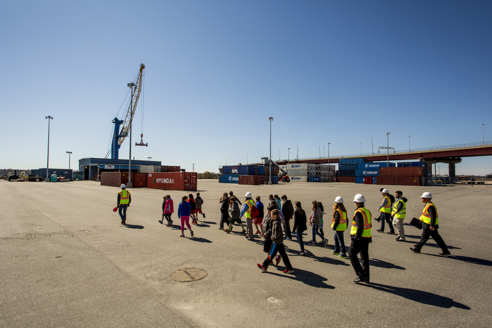 David Arnold of the Maine Port Authority leads the students across the International Marine Terminal.
