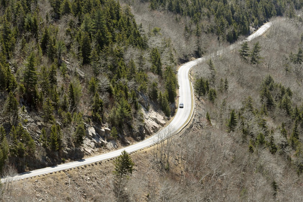 MOUNT DESERT ISLAND, ME - APRIL 30: A lone car travels along the Park Loop Road in Acadia National Park on Saturday, April 30, 2016. The National Park Service estimates that 2.5 million people visit the park annually and many locals take advantage of the lack of crowds during the quiet shoulder seasons. Gregory Rec/Staff Photographer