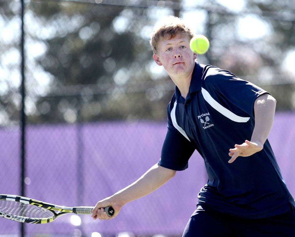 Portland sophomore Quinn Clarke sizes up the ball as he prepares to hit it during a tennis match at Deering Wednesday. Gabe Souza/Staff Photographer