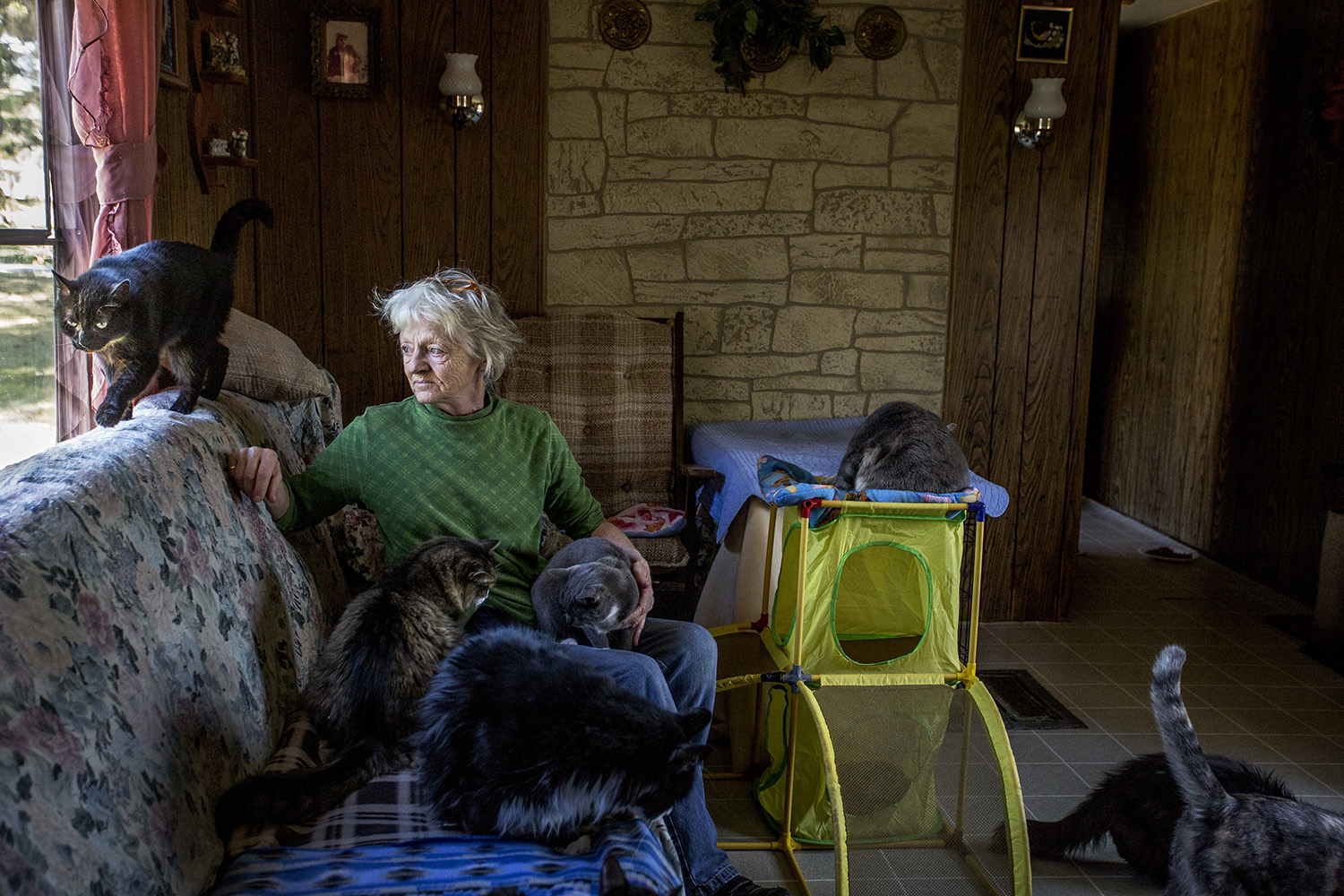 Brenda Jarvis of Dixfield poses for a portrait on a coach in a small trailer in Dixfield. Gabe Souza/Staff Photographer