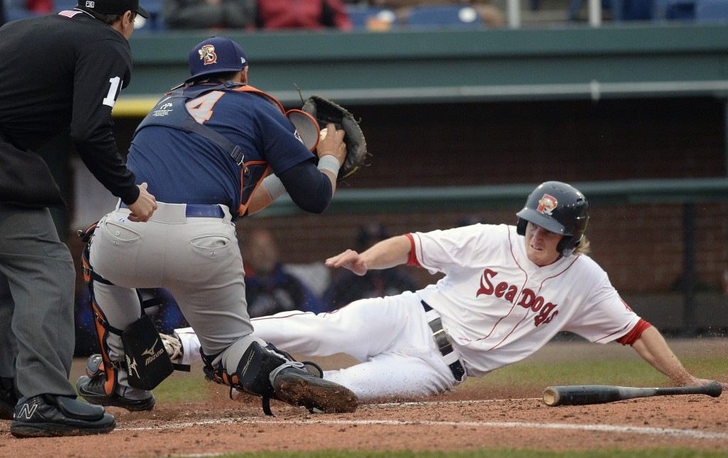 Portland's Derek Miller tries to slide under the tag of Binghamton catcher Xorge Carrillo in the first game of Friday's doubleheader at Hadlock Field. Miller was out on the play.  Shawn Patrick  Ouellette/Staff Photographer