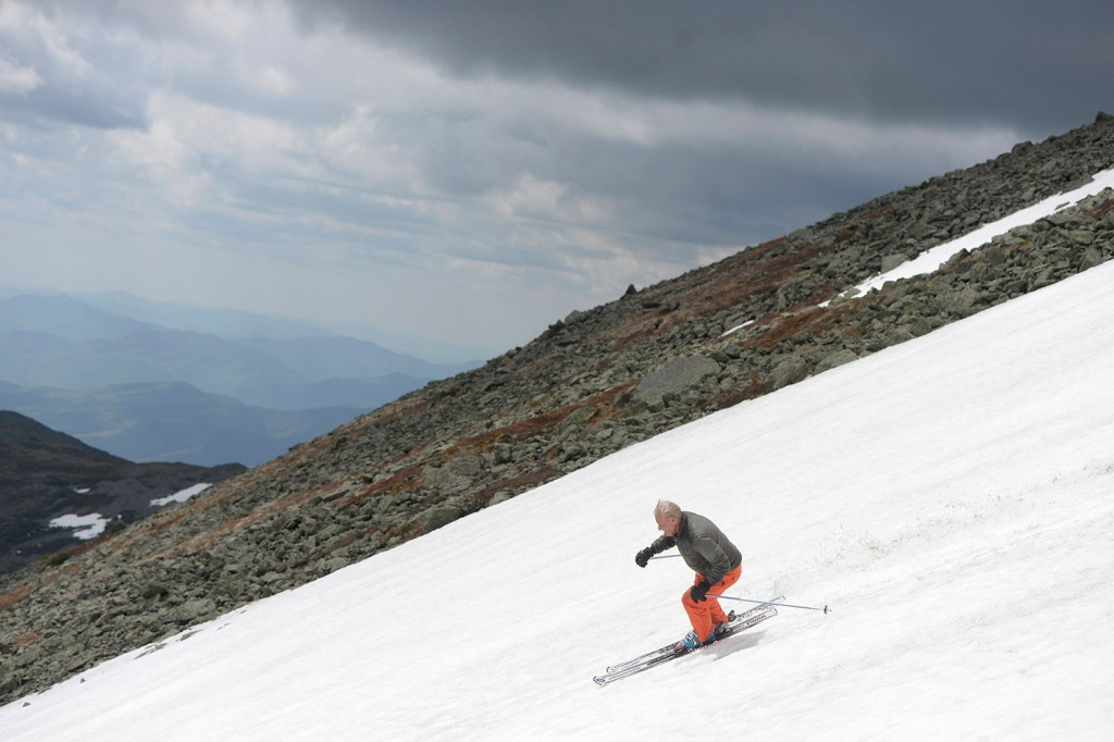 John Christie, then 78, skis down a snowfield near the top of Mount Washington in May of 2015.