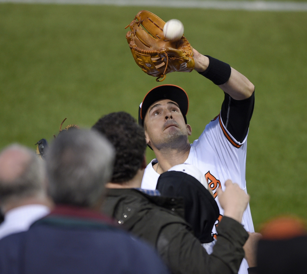 Portland's Ryan Flaherty, who was called up by the Orioles on Tuesday, makes a catch in foul territory on a pop up by  Jacoby Ellsbury of the Yankees.