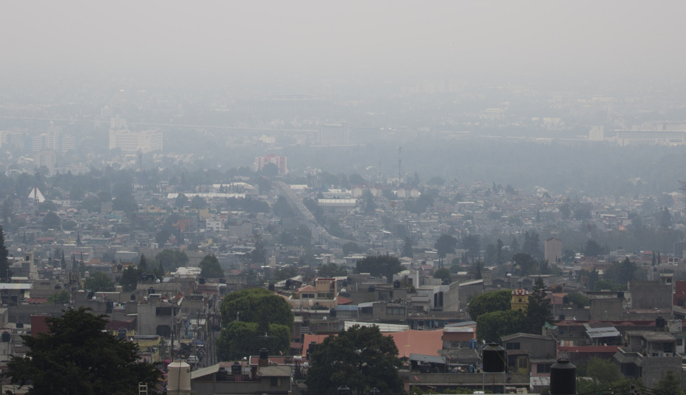 Air pollution hangs over Mexico City on Tuesday despite a cut in traffic. A new pollution alert will require 40 percent of cars and trucks to keep off the streets Thursday.