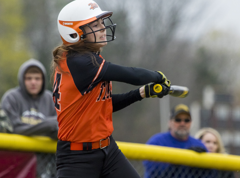 Grace Martin of Biddeford follows through on one of her two hits for Biddeford, driving in two runs against Thornton Academy at Saco.