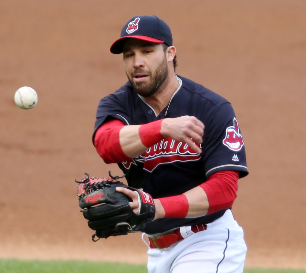 Cleveland second baseman Jason Kipnis throws out Detroit's Justin Upton during the Indians' 4-0 win at home on Thursday night.