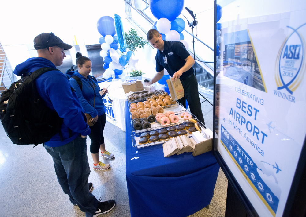 On Friday, Portland International Jetport celebrated its recent recognition by the Airport Council International's Airport Service Quality program as the best airport in North America for its size. Jetport personnel handed out doughnuts and cake, as well as free baggage tags, to passengers  in recognition of their customer service achievement. The honor was based on the results of monthly customer satisfaction surveys. Derek Davis/Staff Photographer