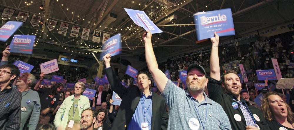 Backers of presidential candidate Sen. Bernie Sanders cheer a speech by Troy Jackson of Allagash, a former state senator who is a representative to the Democratic National Committee, during the party's convention at Cross Insurance Arena on Saturday.
