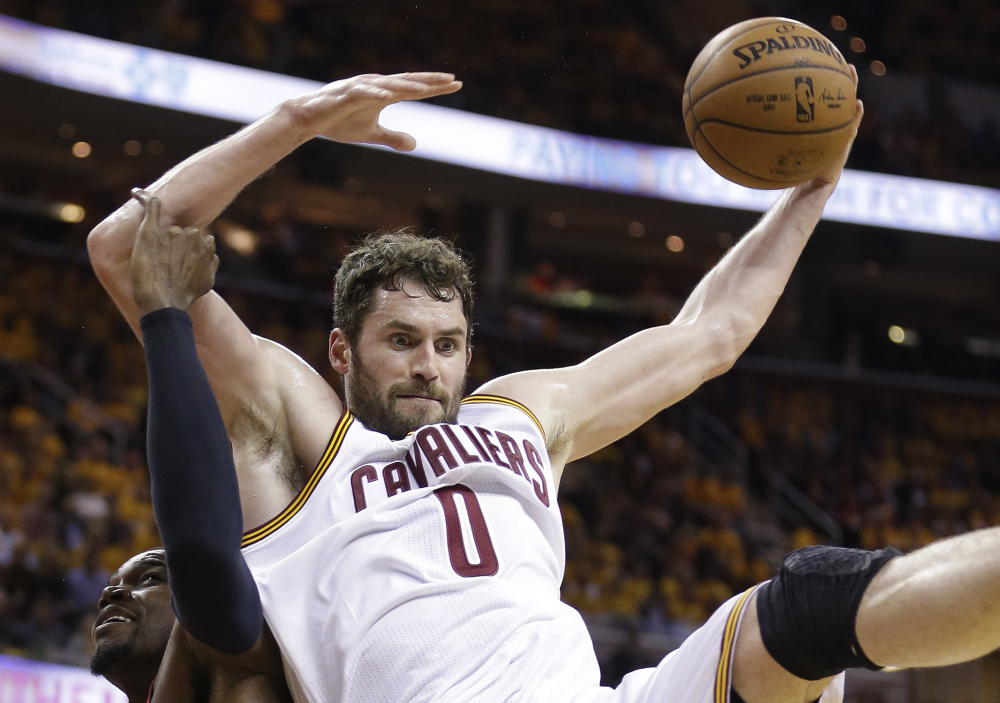 Cavaliers forward Kevin Love grabs during Game 2 of Cleveland's series against Atlanta. Along with 18.9 points per game, Love is averaging 12.5 rebounds in the playoffs, helping the Cavaliers open with an 8-0 run.