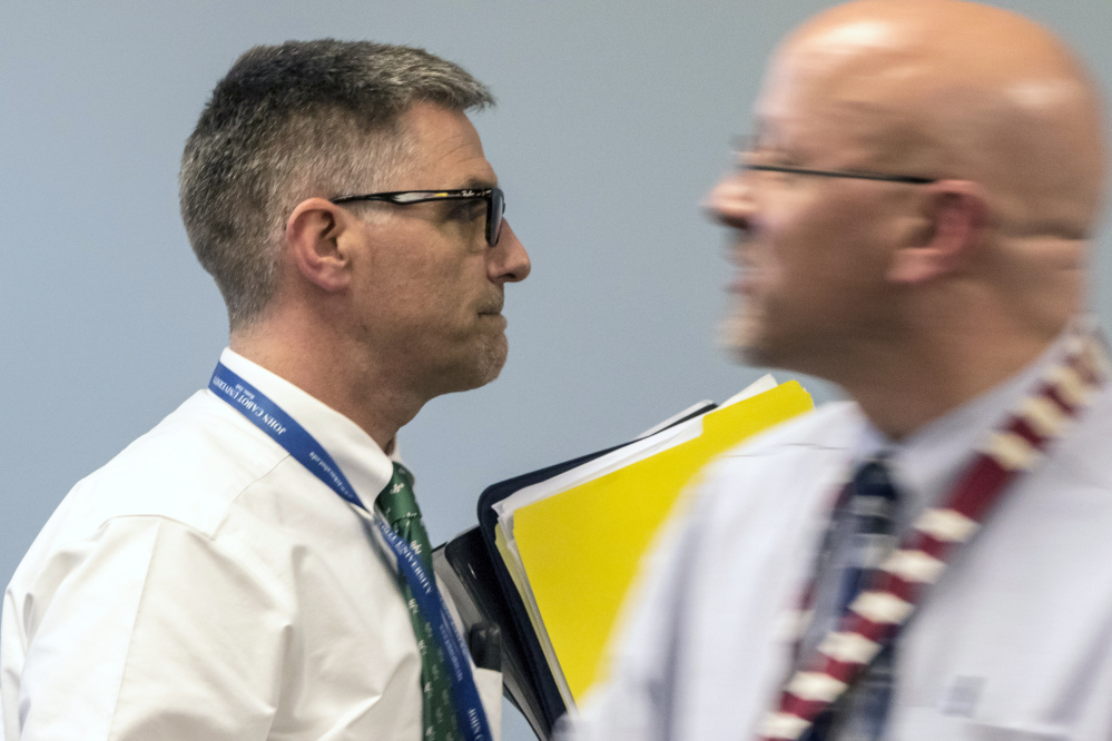 SAD 6 Superintendent Frank Sherburne, left, walks past school board member Daniel Kasprzyk before entering an executive session Tuesday. Kasprzyk tried to stop the board from using its own counsel to investigate a possible nepotism policy violation, but was voted down.