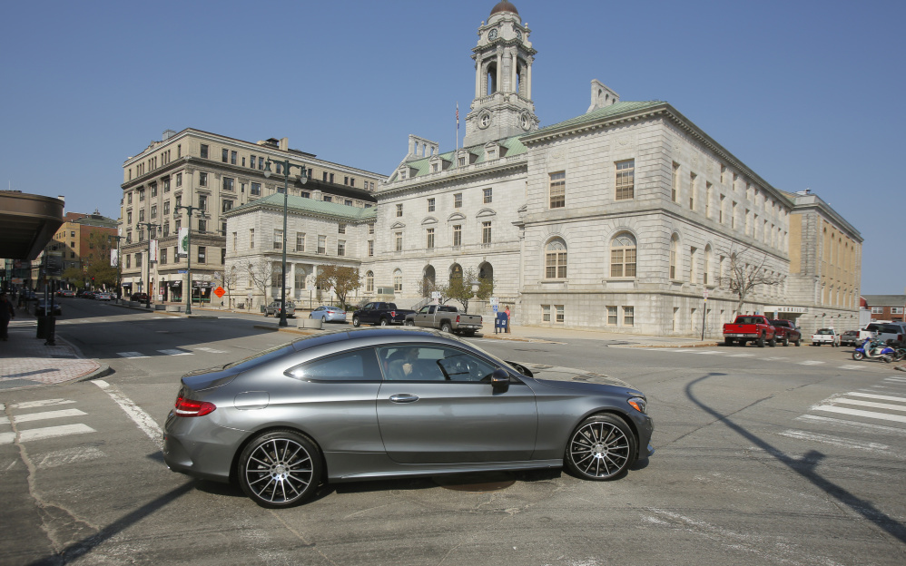 A Mercedes C300 coupe turns onto Congress Street from Market Street at the start of a test drive by an automotive writer Thursday. Mercedes-Benz chose Portland for the national press launch of the newly designed coupe.