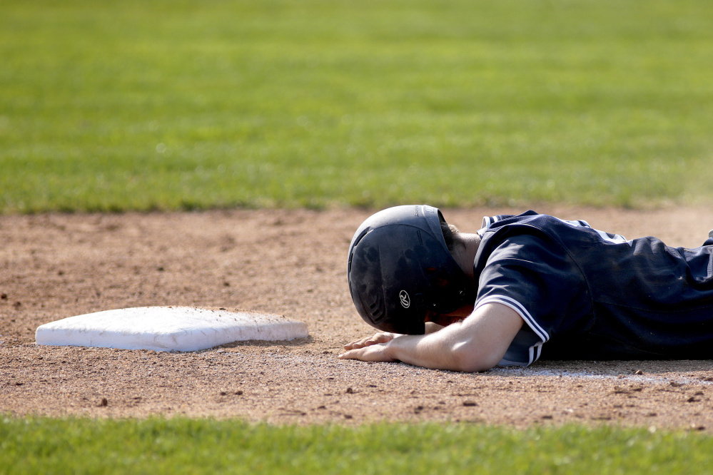 Charles Barnard of Portland takes a breather Thursday after getting picked off at first base following a single during the 8-1 victory against Cheverus. The Bulldogs reached 9-0 and will take on Bonny Eagle on Saturday.
