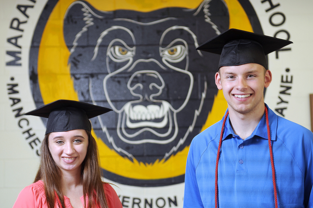 Amy Lapierre and Reid Lanpher will march at two graduations this spring: one for their associate degrees at Thomas College and the other for their high school diplomas at Maranacook Community High School.