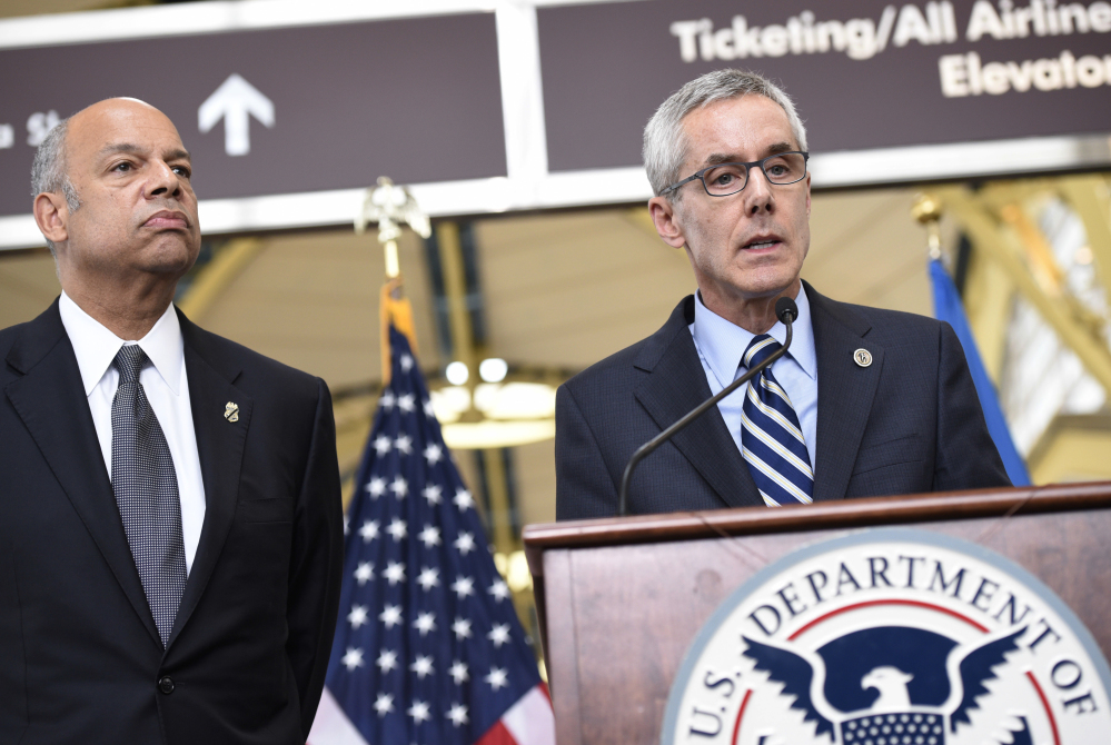 Transportation Security Administration's Peter Neffenger, right, and Homeland Security's Jeh Johnson speak at a news conference Friday.
