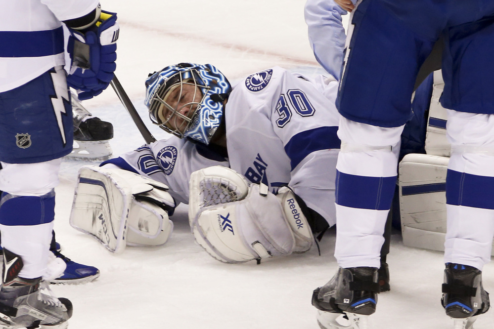 Tampa Bay goalie Ben Bishop grimaces after injuring his left leg in the first period of Game 1 against the Penguins in the Eastern Conference finals Friday in Pittsburgh.