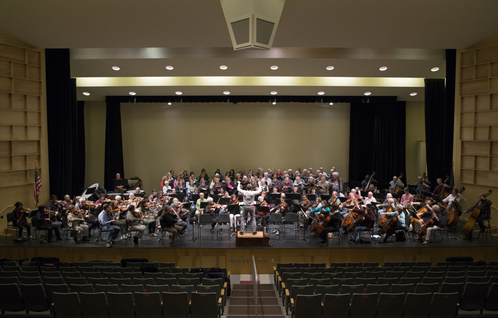 Conductor Rohan Smith, the Midcoast Symphony Orchestra and singers from the Vox Nova Chamber Choir and the Oratorio Chorale rehearse for their weekend performances.