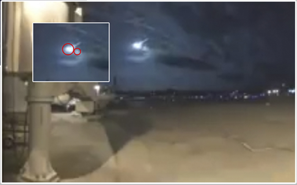 The American Meteor Society determined that the meteoroid seen over the northeastern part of the United States on Tuesday morning broke into two pieces. This is from the Burlington, Vt., airport video that shows the two objects. The inset enlarges the image and the circles indicate the two pieces.