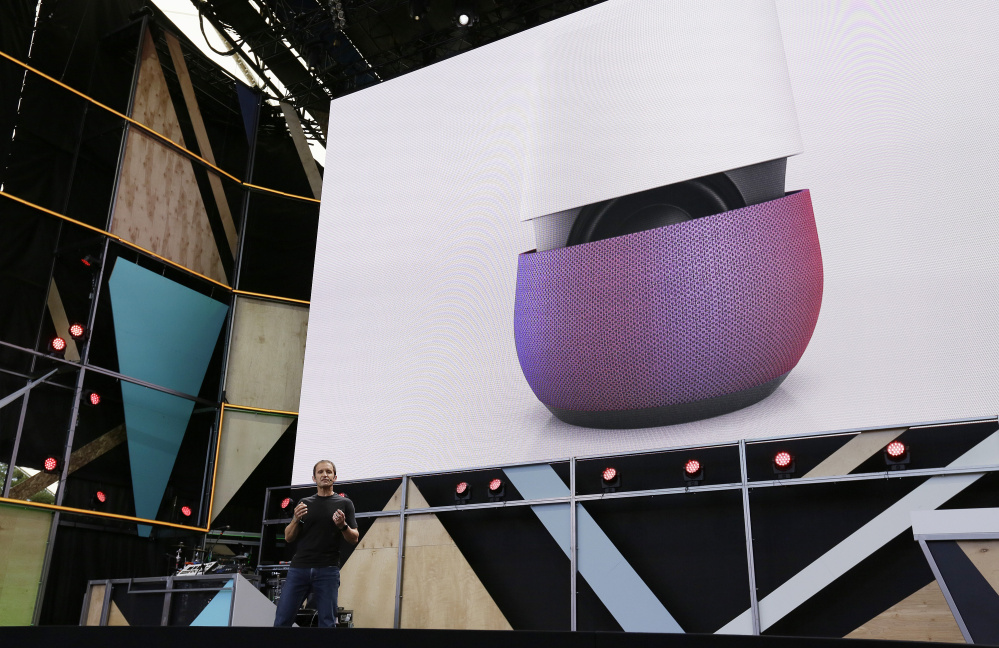 Google vice president Mario Queiroz gestures while introducing the new Google Home device during the keynote address of the Google I/O conference Wednesday, in Mountain View, Calif.
