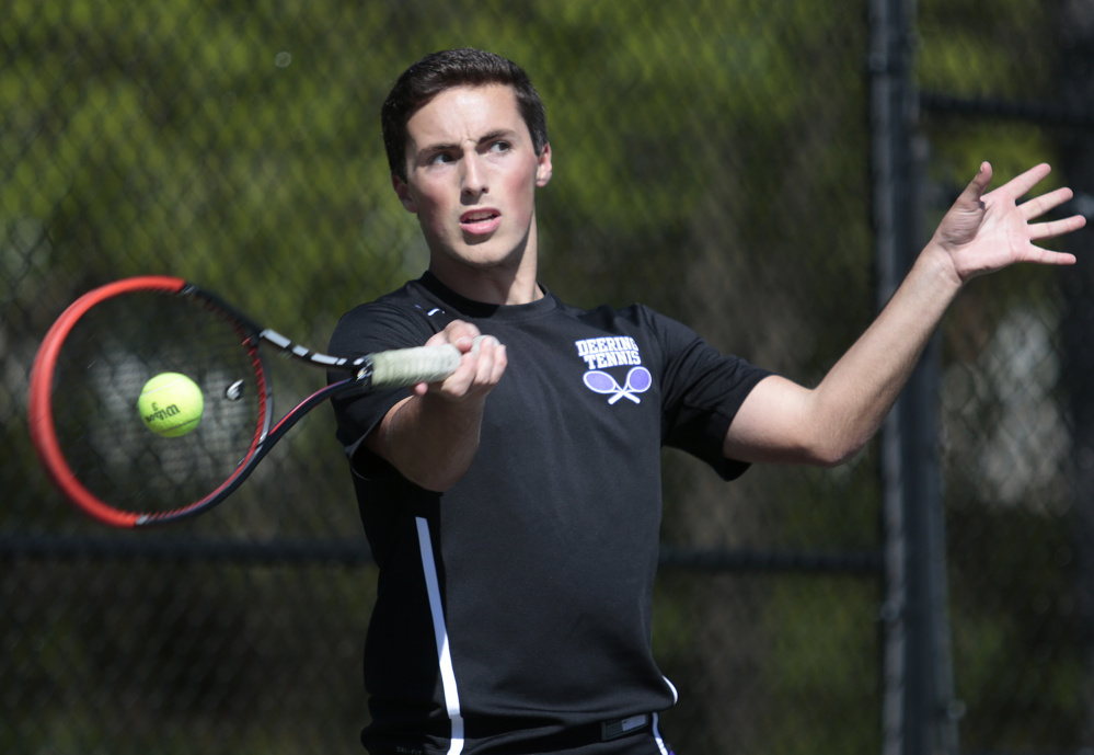 Isaac Finberg of Deering uses his forehand to return the shot to Peter Barry of Portland during their match at Deering High. Barry came away with a 6-1, 4-6, 6-3 victory.