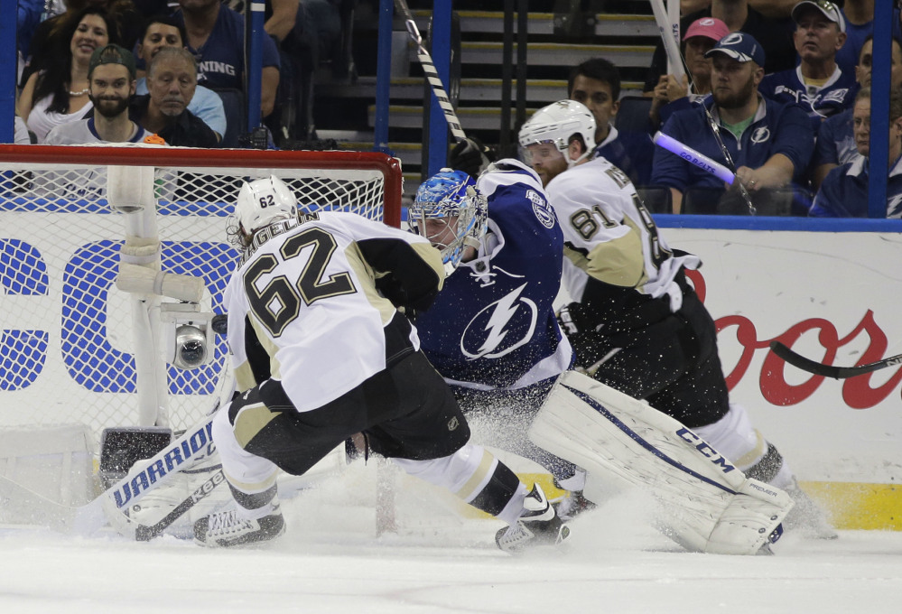Pittsburgh left wing Carl Hagelin scores a goal against Tampa Bay Lightning goalie Andrei Vasilevskiy in the second period of Game 3 of the Eastern Conference finals Wednesday night in Tampa, Fla.