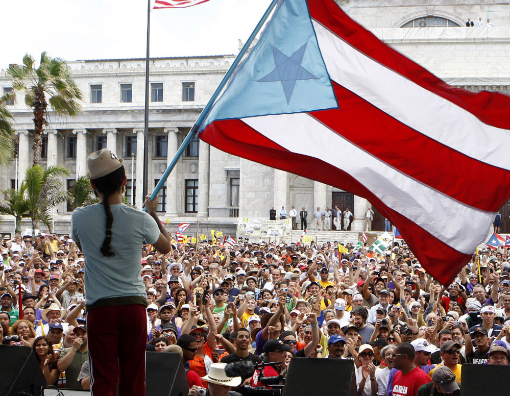 Demonstrators gather in San Juan, Puerto Rico, to protest budget cuts. The U.S. protectorate has been mired in a decade-long recession.